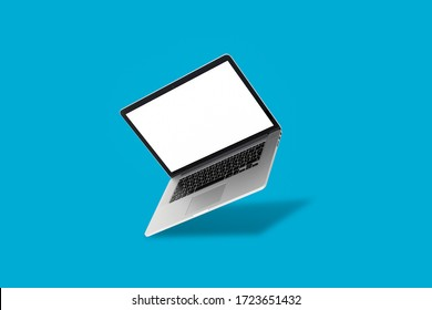 laptop floating in front of a blue background
