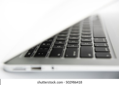 Laptop isolated on white background - macro wallpapers