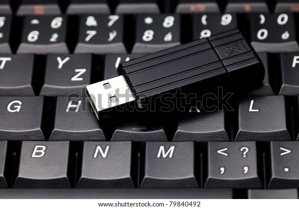 laptop keyboard and flash drive