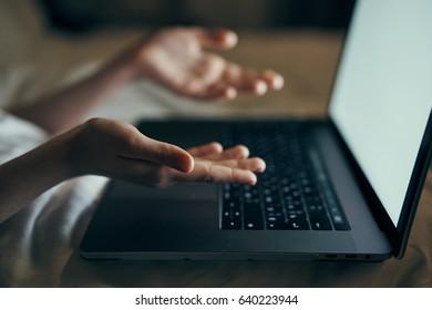 Laptop keyboard, girl's hands