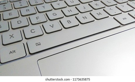 Laptop keyboard grey metallic industrial design.