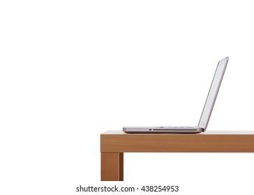 Laptop lays on wooden desk, isolated on white