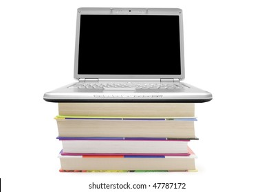 Laptop lying on book isolated on white background