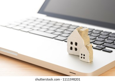 Laptop with Miniature House