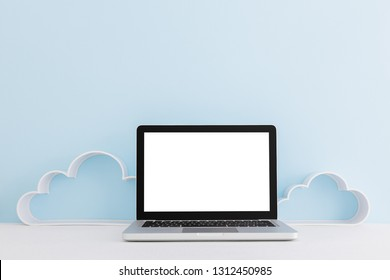 Laptop mock up and clouds decorations on bright blue wall.