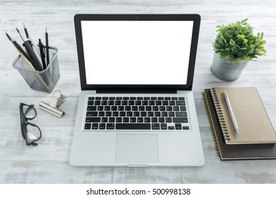 laptop mockup with elements on wooden table