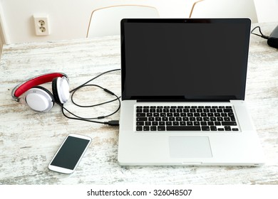 A Laptop in a modern home office setup on a wooden Table.