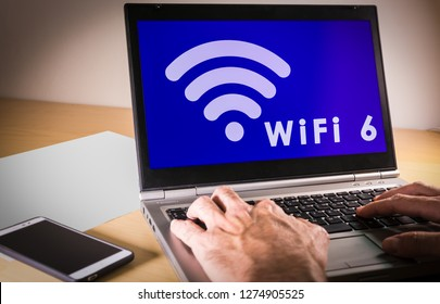 Laptop with new wifi 6 on the screen.Wi-fi 6 is the next generation Wi-fi connectivity with high capacity, coverage and performance.