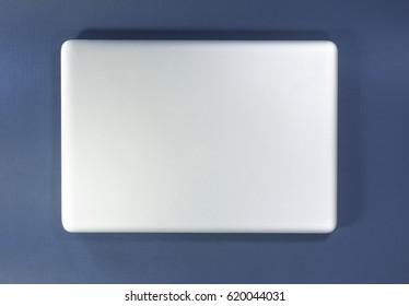A Laptop on blue background