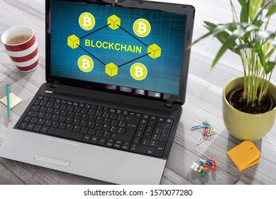 Laptop on a desk with blockchain concept on the screen