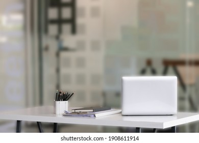 Laptop on desk with blur background. Workspace, office room concept