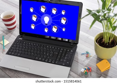 Laptop on a desk with brainstorming concept on the screen