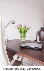 Laptop on the desk in designed home office