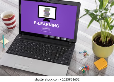 Laptop on a desk with e-learning concept on the screen