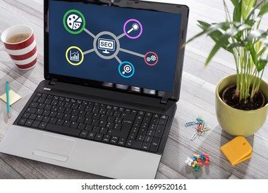 Laptop on a desk with seo concept on the screen