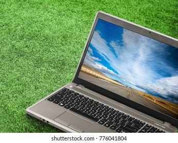 Laptop on The Grass with Infinity Road
