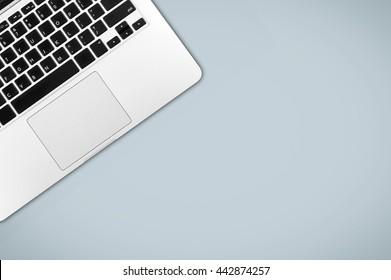Laptop on office desk copy space