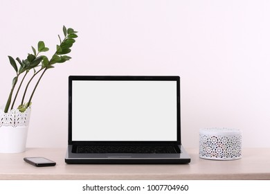 Laptop on office desk isolated on white background.