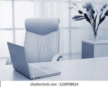 laptop on table of director at modern office