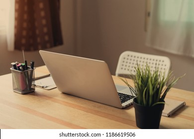Laptop on table in the office room background, for graphics display montage. Take your screen to put on advertising.