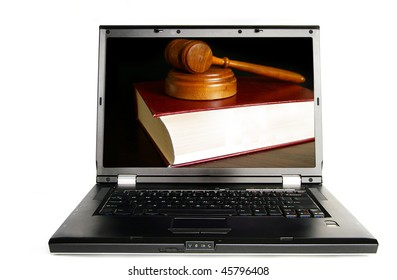 Laptop on white with a lawbook and court gavel