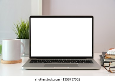 Laptop on white wooden business workspace desk