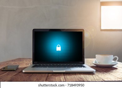 Laptop on wooden desk with security concept on screen, Business, technology, internet and networking concept.