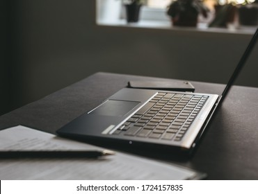 Laptop on the workspace desk with documents. Business workspace concept.