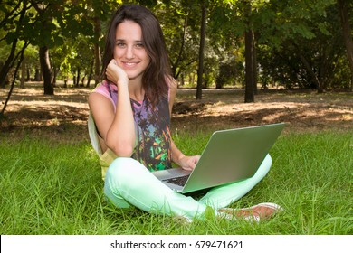 With a laptop in the open air