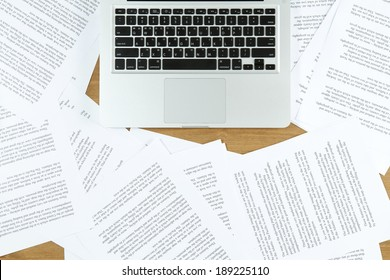 laptop with paper scattered