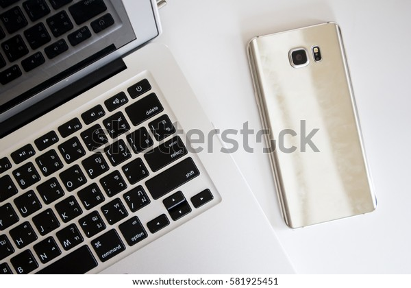 Laptop with Phone, Top View