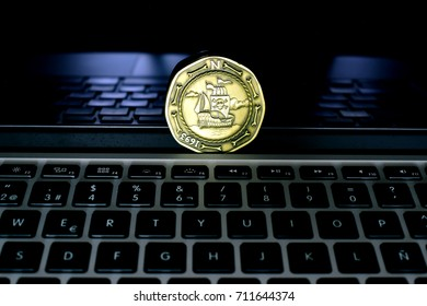 Laptop with pirate coin over screen