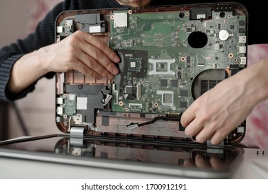 Laptop repair. Disassembled computer parts. PC electronic components. Closeup of keyboard, hdd, motherboard cpu