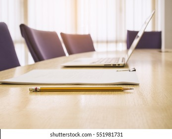 Laptop and report document paper on Table Business start up Office Meeting Boardroom