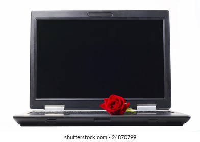 Laptop with rose isolated