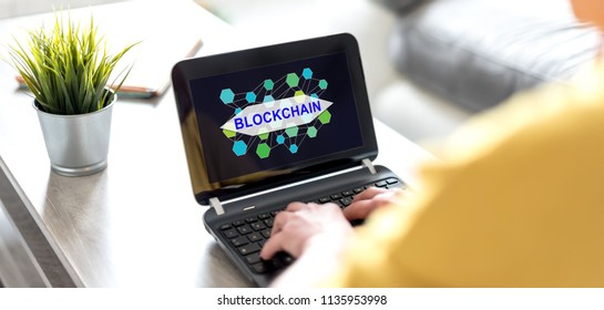 Laptop screen displaying a blockchain concept