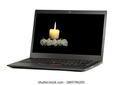 Laptop screen, Funeral flower, White roses with a burning candle on the dark background. online digital funeral business concept. concepts of digital identities after pass away