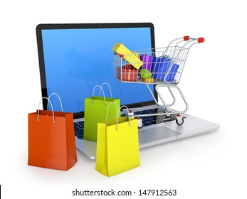 Laptop with shopping bags, shopping cart, and gift boxes isolated on white. Electronic commerce concept.