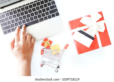 Laptop with shopping basket and credit card on white background - Online shopping concept
