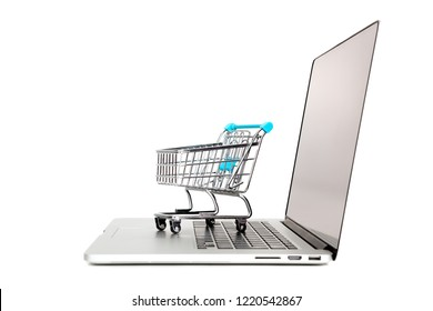 Laptop with small shopping cart isolated in white
