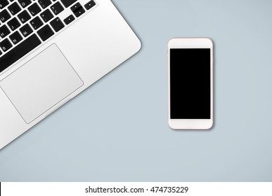 Laptop and smart phone on office desk
