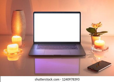 Laptop and smartphone on a glass table.