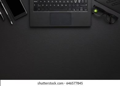Laptop With Smartphone, Pens And Eyeglasses On Gray Desk