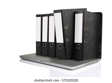 Laptop with some folders getting out the screen isolated on white background