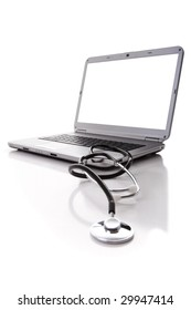 laptop with a stethoscope for good maintenance (selective focus)