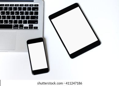 Laptop tablet and smartphone on white background