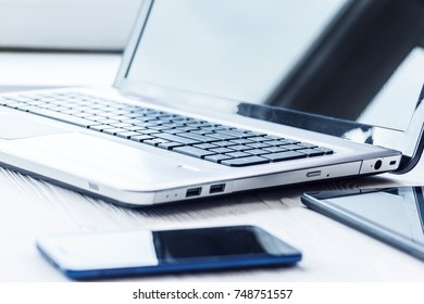 Laptop with tablet and smartphone on white background