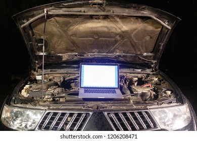 Laptop torque figures and horsepower is the engine of the vehicle for diagnostics and configuration. Diagnostic machines is ready for use with the car. Broken car in auto repair shop. Auto service.