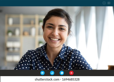 Laptop web cam view head shot of indian woman. E-date online services, video call using phone or pc, distance chat with mates common task, conversation between friends, job interview remotely concept - Shutterstock ID 1694685328