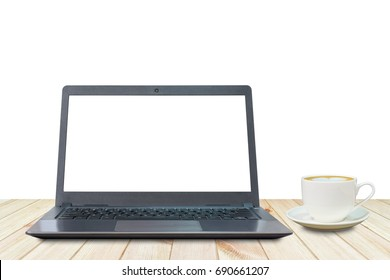 Laptop with white screen and a cup of coffee on wooden table with white background